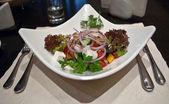 Greek salad in restaurant — Stock Photo