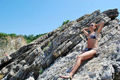 Woman sitting on a rock — Stock Photo