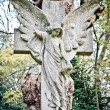 Angel on cross statue — Stock Photo #19716765