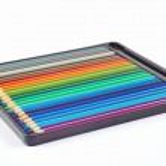 Set of color pencils in black pencil case — Stock Photo #15652063