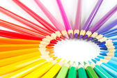 Circle of colored pencils on a white background — Stock Photo