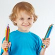 Young blond boy holds color pencils on a white background — Stock Photo #16044399