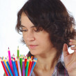 Stock Photo: Young womwith color pencils on white background