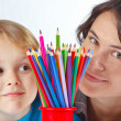Little boy with his mother with color pencils on a white background — Stock Photo #16048535