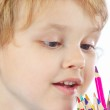 Young blond boy looks on color pencils on a white background — Stock Photo #16048977