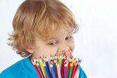 Menino bonito parece em lápis de cor sobre um fundo branco — Fotografia Stock