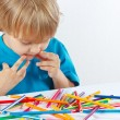 Little boy at the table with color pencils — Stock Photo #16770053