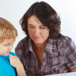 Little cute boy with his mother draws with color pencils — Stok fotoğraf