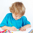Little cute boy draws with color pencils — Stok fotoğraf