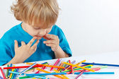 Little boy at the table with color pencils — Stock Photo