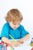 Little child draws with color pencils — Stock Photo