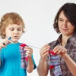 Little boy helps her mother to hang up your socks — Stock Photo