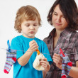 Little boy helps her mother to hang up your toy and socks — Stock Photo