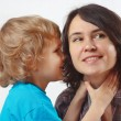 Young cute boy whispers something to his mother — Stock Photo #19434341