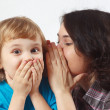 Mother whispers secret to her little son — Stock Photo #19435175