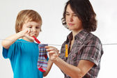 Mother with her son hanging clothes — Stock Photo