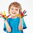 Smiling boy with painted hands on white background — Stock Photo #26487041