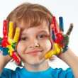 Little boy with painted hands on white background — ストック写真