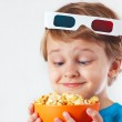 Little funny boy in 3D glasses with bowl of popcorn — Stock Photo #32290653