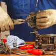 Stock Photo: Servicemrepairing old car engine carburetor