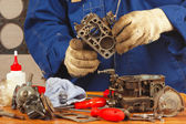 Mechanic repairing old car engine carburetor — Stock Photo