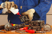 Master repairing parts of car engine in the workshop — Stock Photo