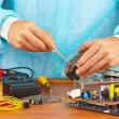 Repair of electronic devices in service workshop — Stock Photo