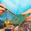 Soldering electronic board of device in service workshop — Stock Photo #37295417