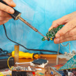 Repair electronic board of device with soldering iron — Stock Photo #37295431