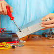 Master parses electronic hardware for checking in service workshop — Stock Photo #37295507