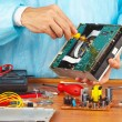 Master parses electronic device for repair in service workshop — Stock Photo #37295535