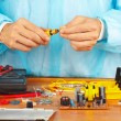 Hands service engineer of electronic equipment with screwdriver — Stock Photo