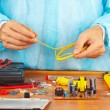 Master repairing electronic hardware in service workshop — Stock Photo