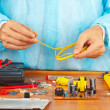 Master repairing electronic hardware in service workshop — Stock Photo #37295579