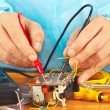 Master measures parameters of electronic device with multimeter — Stock Photo #37295637