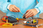 Repair of electronic devices in service workshop — 图库照片