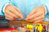 Master repairing electronic components in service workshop — Stock Photo