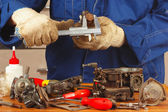 Repair of old parts car engine in workshop — Stock Photo