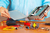 Master servicing electronic components in service workshop — Stock Photo