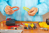 Hands engineer repairing electronic devices in service workshop — Stock Photo