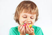 Child with sweets and colored jelly candies on white background — Stock Photo