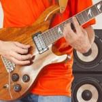 Постер, плакат: Hands of rock musician put guitar chords