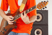 Posing hands of musician playing the electric guitar — Stok fotoğraf