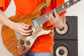 Hands of rock musician put guitar chords — Stock Photo