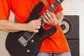 Hands of the rock musician playing the electric guitar — Stock Photo