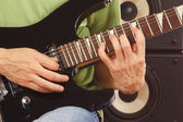 Hands of musician put guitar chords close up — Stock Photo