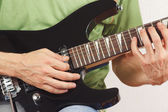 Guitarist playing the electric guitar close up — Stock Photo