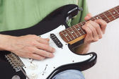 Posing hands of rock musician playing the electric guitar — Stok fotoğraf