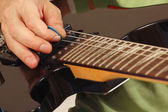 Rock guitarist playing the electric guitar closeup — Stock Photo