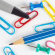 Pencil, pen, paperclip and thumbtack on white desktop closeup — Stock Photo #48027277
